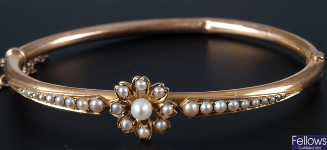 Early 20th century gold hinged bangle with seed