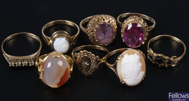 Eight assorted gold mounted stone set dress rings