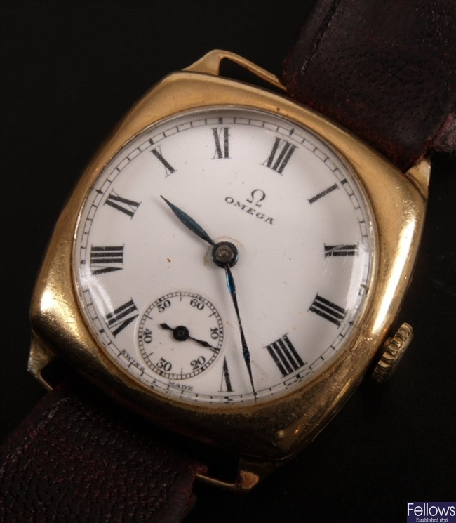 OMEGA - a 1930's gentleman's 9ct gold cushion