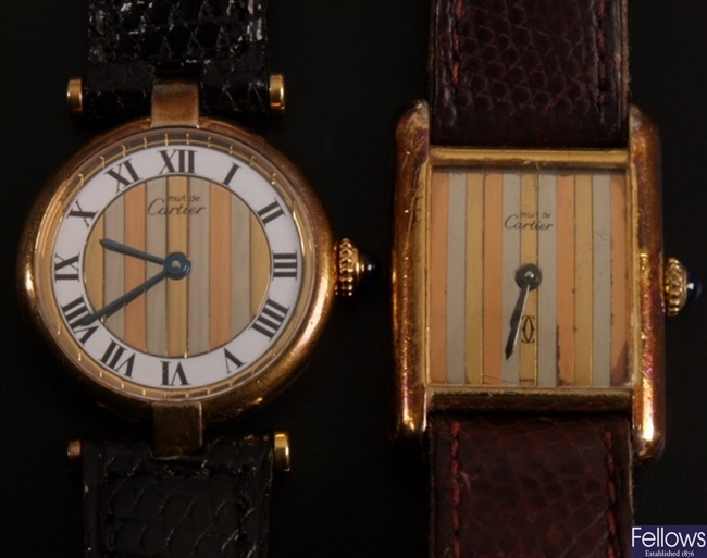 CARTIER - a ladies gold plate on silver round