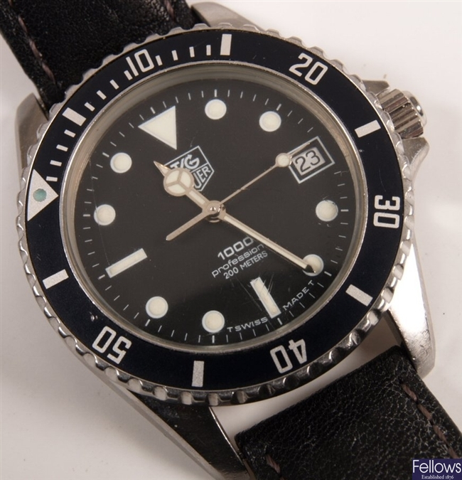 TAG HEUER - a gentleman's 1000 series with date