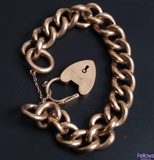 9ct rose gold hollow curb bracelet and padlock.