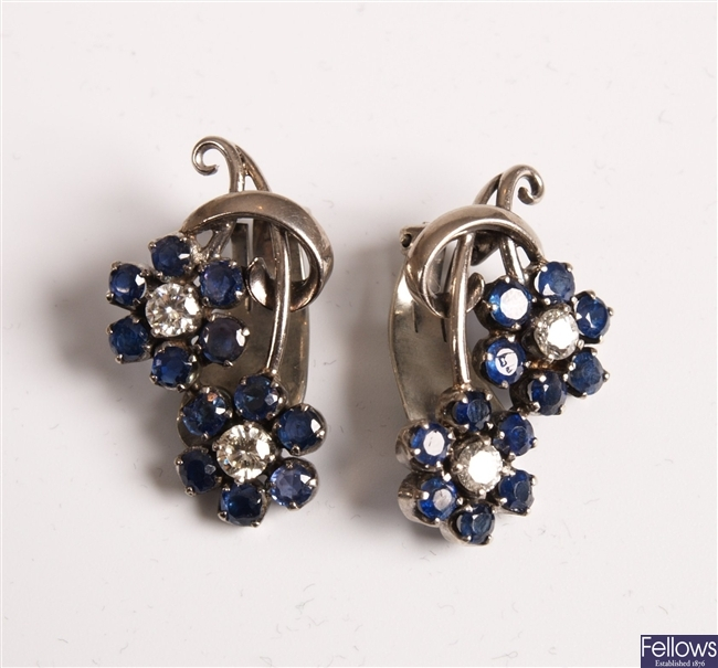 14K white gold floral formed earrings set with