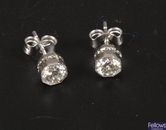 A pair of 18ct white gold round brilliant diamond