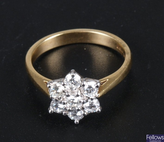 18ct gold seven stone all diamond cluster ring of