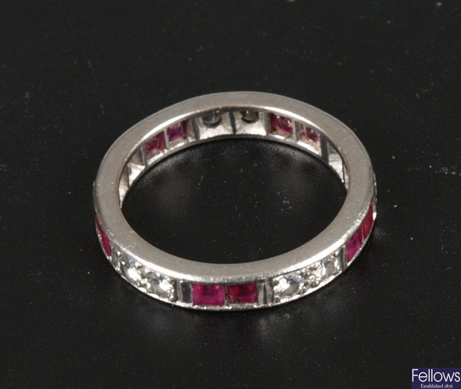 A  white metal (tests as 18ct) full eternity ring