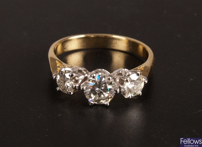 Claw set round brilliant cut diamond three stone