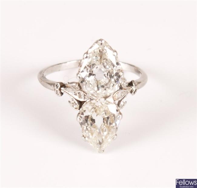 Platinum two stone pear shape diamond up finger