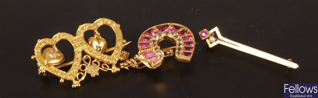 Three fancy stone set brooches to include a red