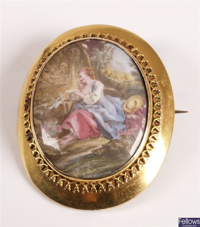 Oval brooch with central porcelain plaque