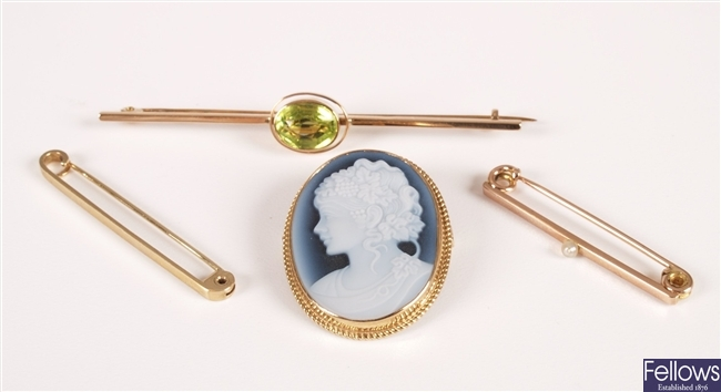 Four brooches, to include 9ct gold laser cameo
