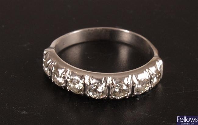 Round brilliant diamond set half eternity ring