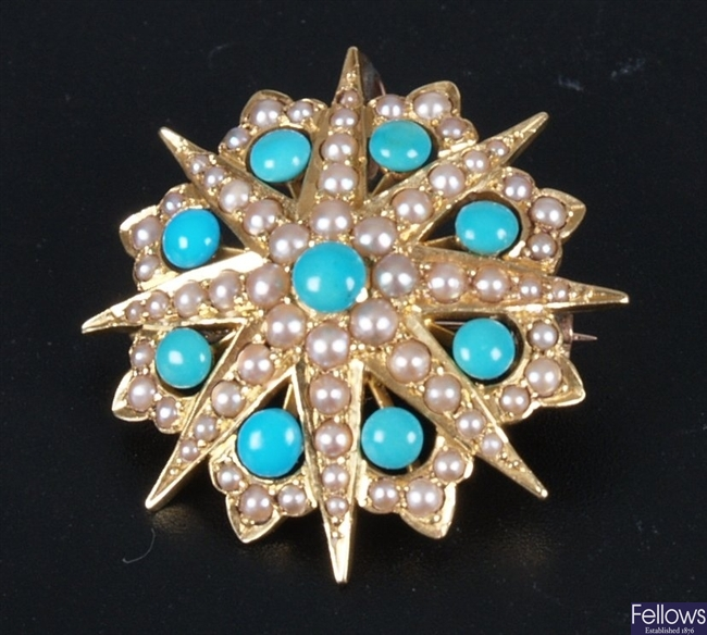 Turquoise and seed pearl brooch in a star design.