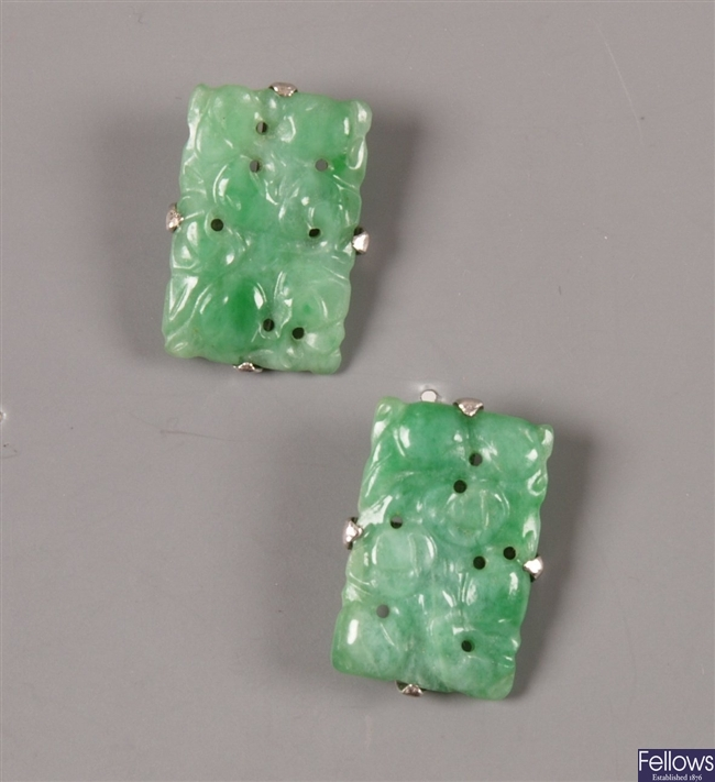 A pair of rectangular apple green carved jade