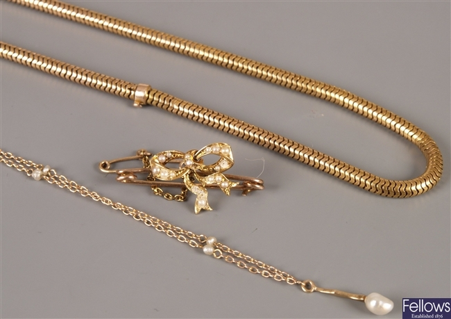 Two unmarked gold chains - a snake line necklace