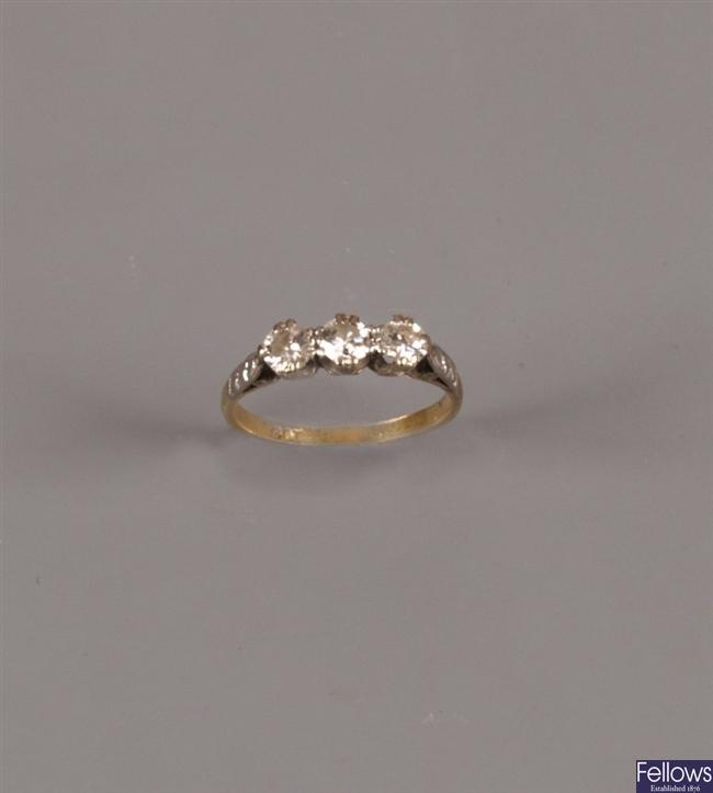 18ct gold claw set three stone diamond ring of