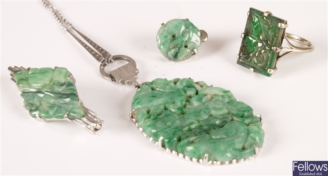 Four pieces of green jade jewellery - an oval
