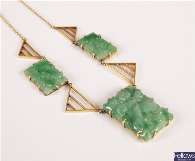 A green jade set necklace with three rectangular