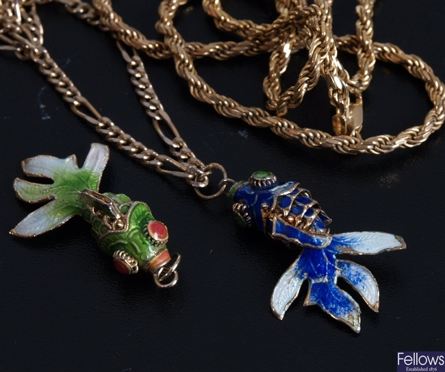 Two enameled fish design pendants, to include a