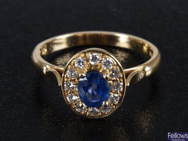 18ct all yellow gold mounted oval sapphire ring