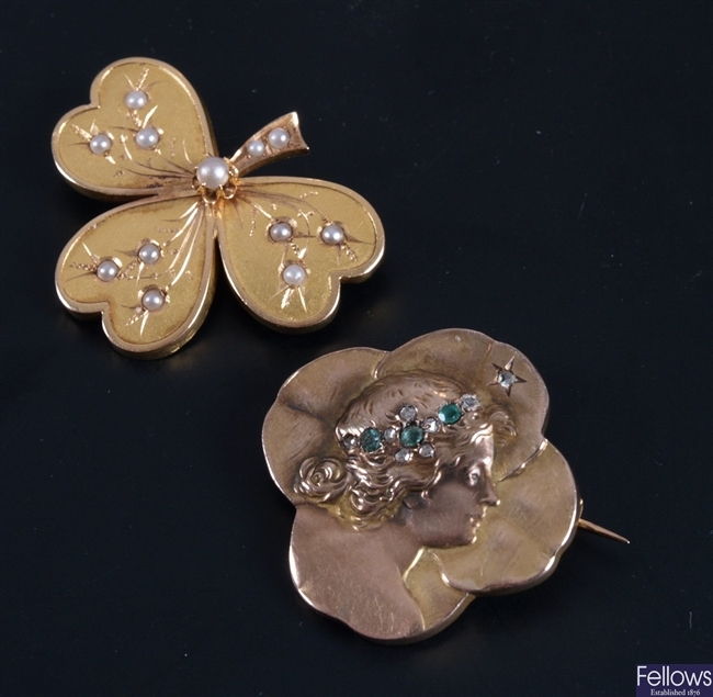 Two continental gold brooches to include a seed