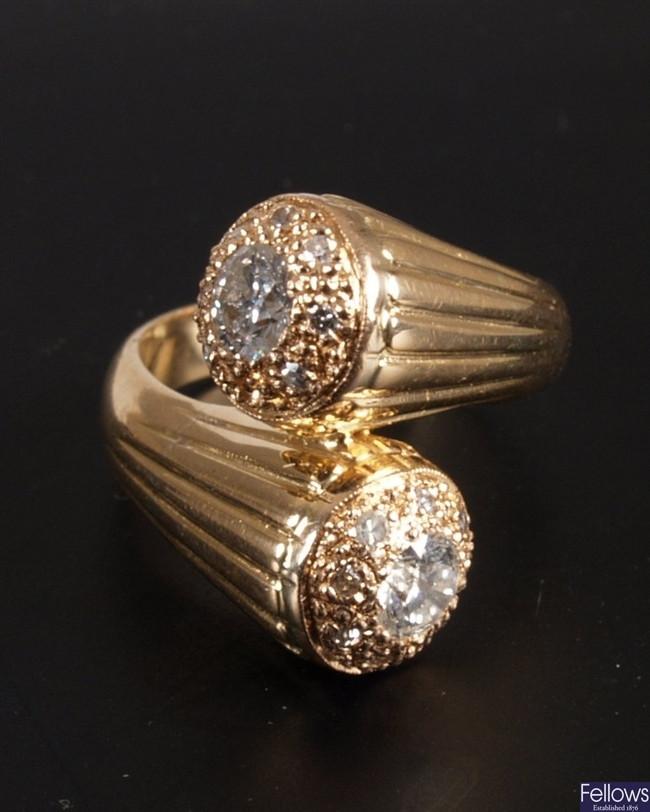 Continental gold mounted crossover ring