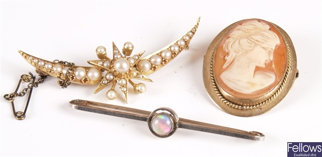 Five brooches to include a seed pearl crescent, a