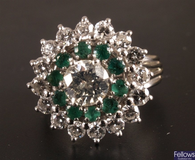 Diamond and emerald cluster ring mounted in 18ct