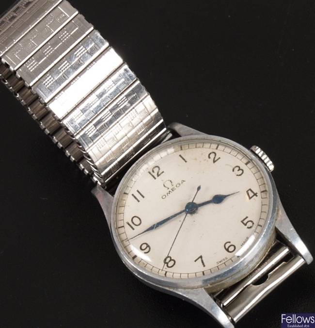 OMEGA - a base metal cased wrist watch with a