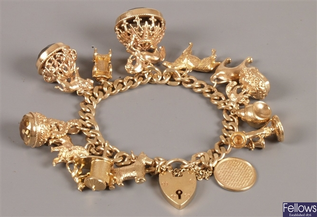 9ct gold flat curb link bracelet with charms