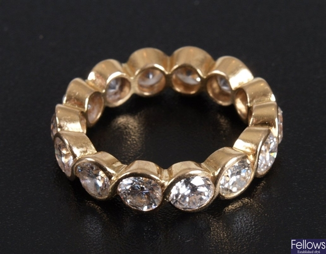 A diamond full eternity ring of approximately