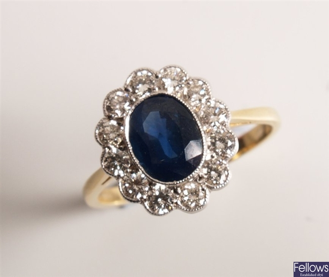 18ct stamped oval sapphire and diamond cluster