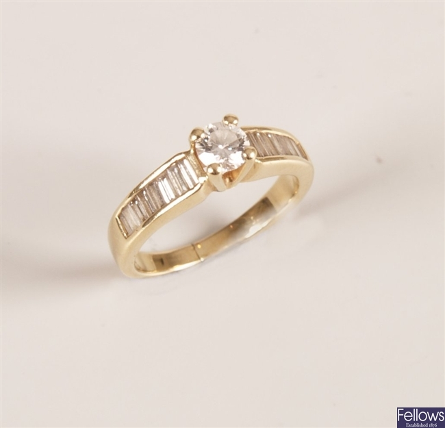 A 15K stamped dress ring set with a center single