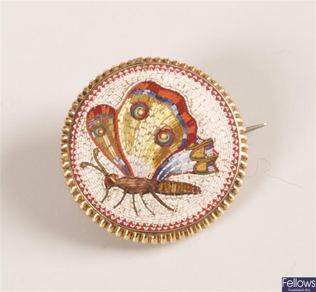 A Micro mosaic circular brooch depicting a