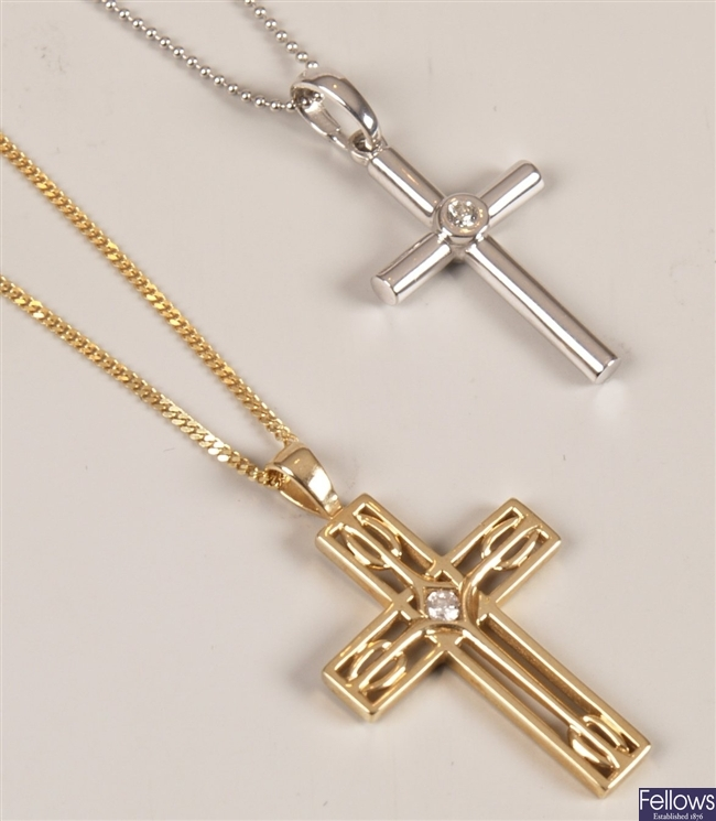 Two 9ct gold diamond set crosses, consisting of a
