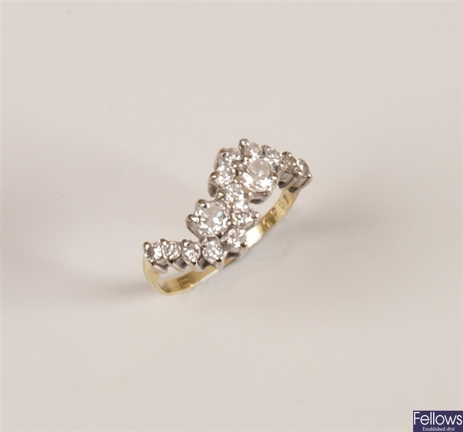 Round brilliant diamond crossover ring in a wavy
