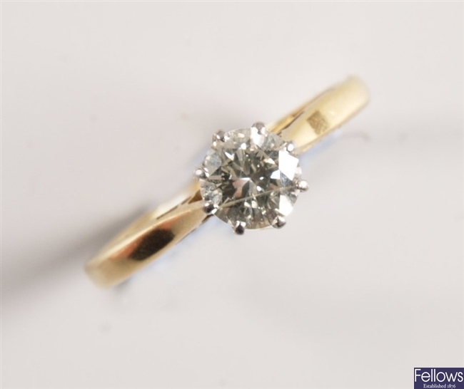 18ct gold and platinum claw set single stone