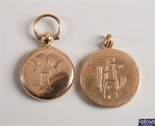 Two circular lockets with front engraved