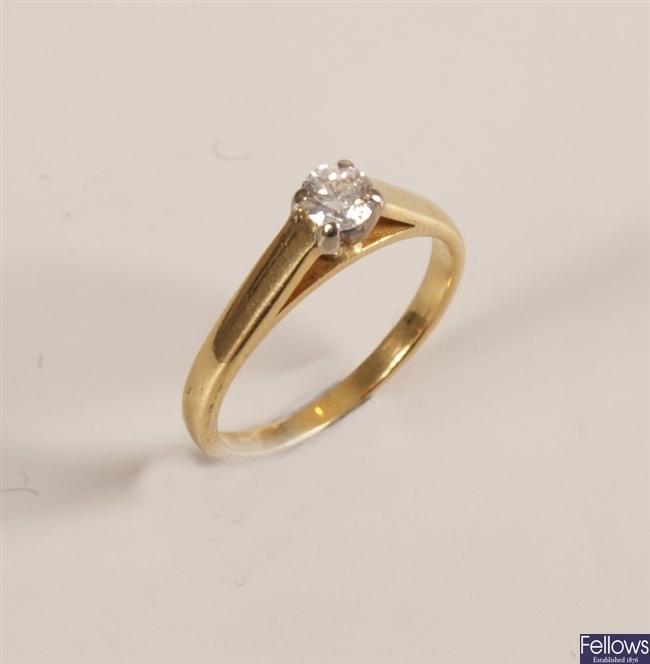 18ct gold single stone round brilliant ring.