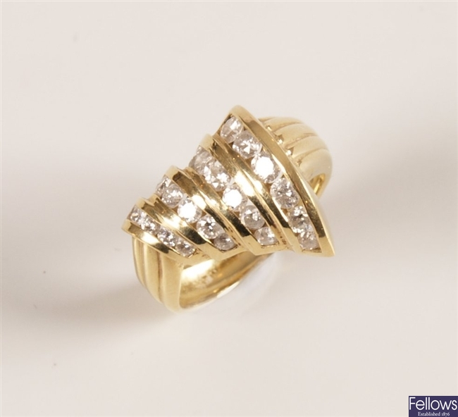 18ct gold diamond set ring with four graduated
