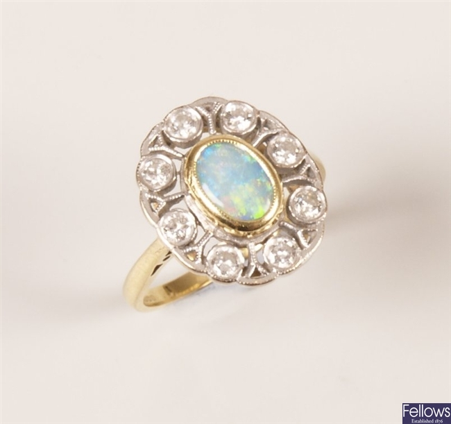 18ct gold opal and diamond cluster ring with a