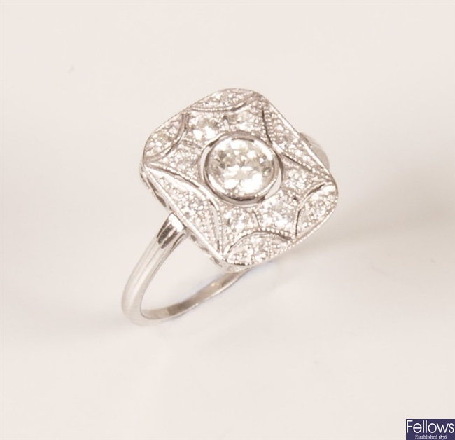 Diamond set cluster ring, with a central rub over