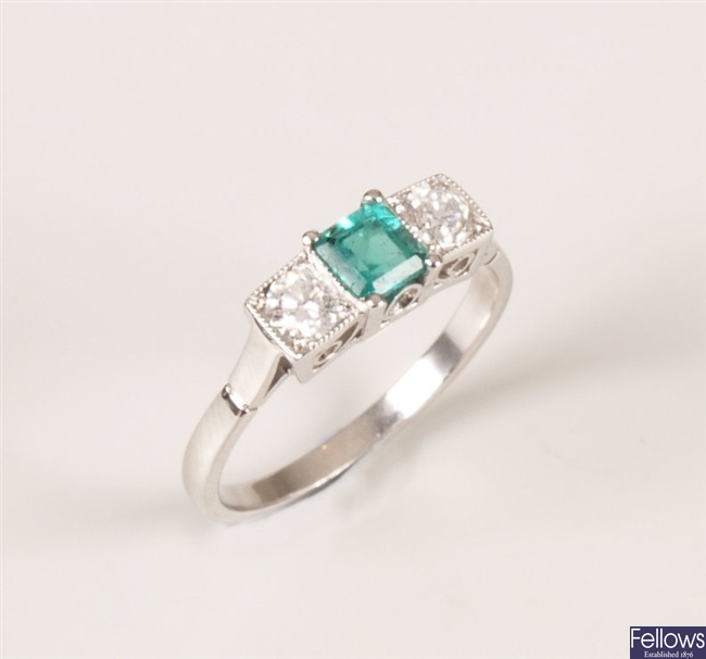 Three stone emerald and diamond set ring, with a