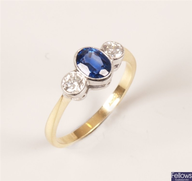 18ct gold three stone sapphire and diamond ring,
