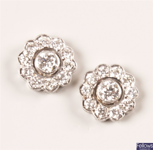 Pair of 18ct white gold diamond set cluster