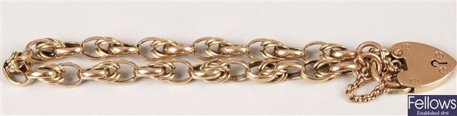 9ct gold oval link bracelet with heart padlock