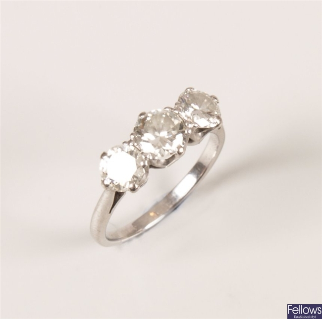 Platinum three stone diamond ring set round