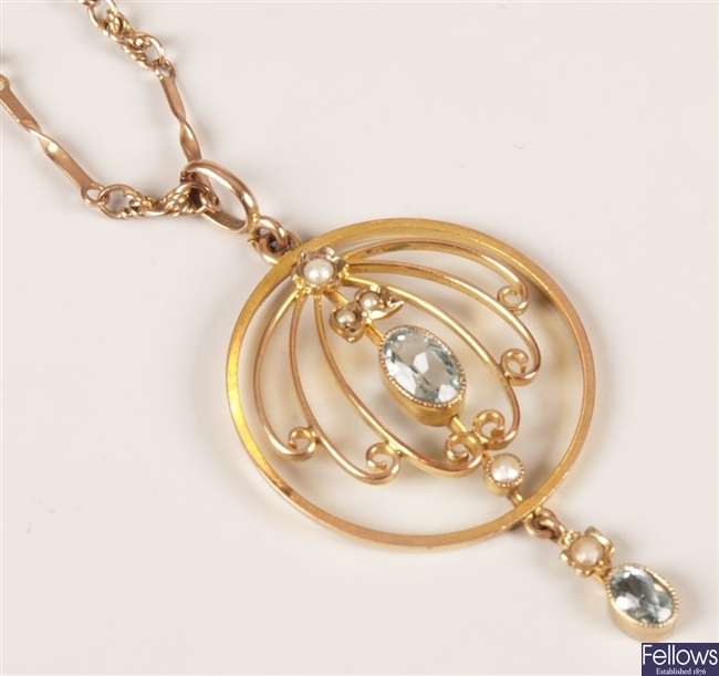 Aquamarine and seed pearl pendant with a central