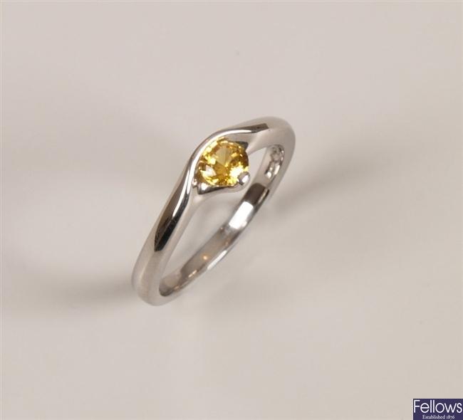 Platinum and yellow sapphire single stone ring.