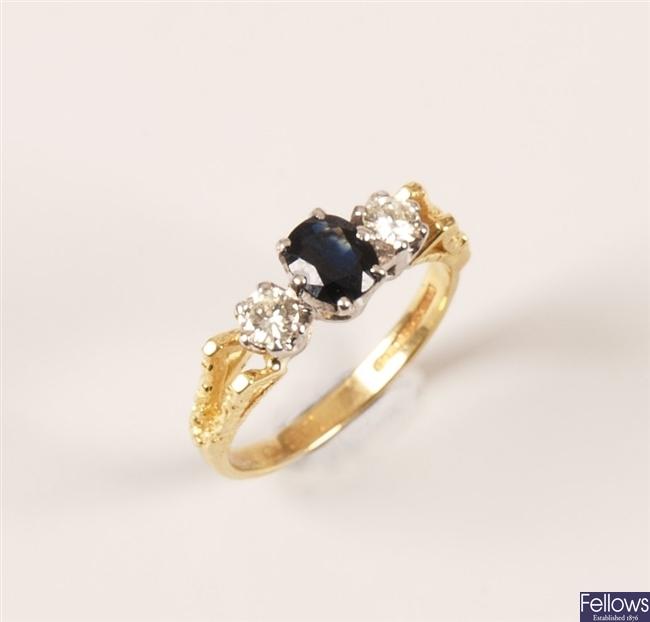 18ct gold three stone sapphire and diamond set